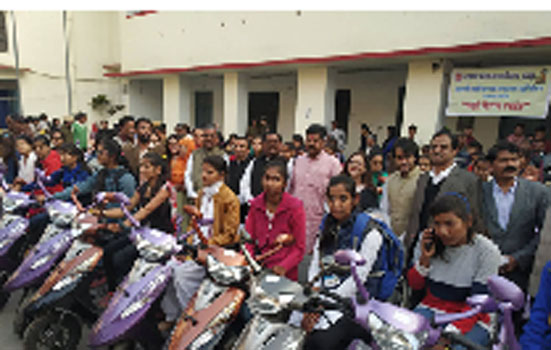 Scooty distributed to talented students