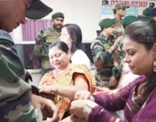 Bound soldiers with Raksha Sutra